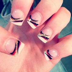 French tip with red black and gold sparkle design