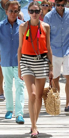 Olivia Palermo's 35 Best Looks Ever - Orange Top and Striped Shorts from #InStyle What I love about this photo is theres Valentino right behind her. lol