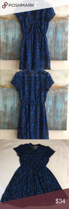Anthropologie Mimi Chica Sheer Dress Size Small Oh so feminine Anthro Mimi Chica sheer dress with short sleeves, elastic banded waist, tab collar and floral print. Size Small. Color Blue/Black. Material Poly. Measurements shoulders: 14, pits: 17, top to bottom: 35. Anthropologie Dresses