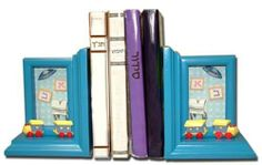 """Boy's Room Bookends (Set Of Two)- 803015 by Judaica. $24.95. Room bookends. Blue - Boy. Boy's Room Bookends (Set Of Two)- This set of 3D blue wooden bookends will enhance any boy's room. A colorful wooden train runs along the front of each bookend while the background is enhanced with lifelike kippah, tzitzis and aleph-beis blocks carefully encased in glass frame. Size 5.5"""" x 4"""" x 7""""."""