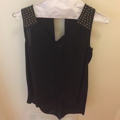 Black top with leather straps & gold embellishment Black tank with leather and gold studded straps. Cute keyhole back! Longer in the back. From fabrik. Only worn once! Tops Tank Tops