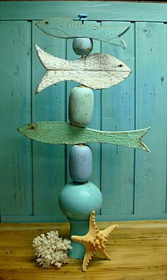 School of Fish with metal rod, wood cut out fish and corks/wood knobs  Sculpture