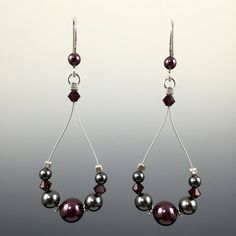 Swarovski crystals and Swarovski crystal pearls Hand formed Sterling silver earwires with rubber earring backers Beads are strung on a colored, stainless steel