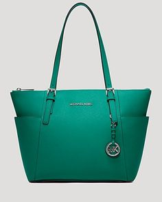 Michael Michael Kors' signature tote arrives in saffiano leather with room for all the daily essentials. It's so ready for takeoff. | Saffiano leather | Imported | Double handles  | Zip closure; lined