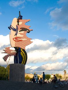 Skateboarding next to the Barcelona Face, on the Passeig Colom at the Port Vell. Designed by Roy Lichtenstein, made by Diego Delgado for the mosaics Barcelona Olympic Games - 2010