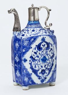 Ewer, Iznik, Turkey, ca. 1520-1525. Fritware, underglaze painted in cobalt blue, glazed; later silver mounts. Height: 23.8 cm, Width: 15 cm including spout, Depth: 11 cm. Museum number: 349-1897 © V Images.