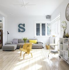 Love the grey couch, vintage letter s & pop of yellow