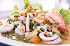 Learn to make a delicious spicy seafood salad, Yum Talay, in your home kitchen with our easy to make Yum Talay recipe at thaicuisine.tv