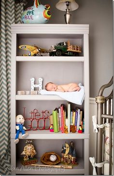 Love the idea of a newborn shoot using the baby's nursery -- how cute is he on his own bookshelf?!