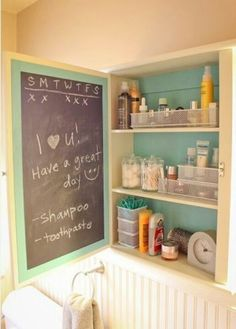 Medicine cabinet with chalkboard.