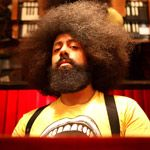 Reggie Watts, you really have to see what this guy does... mix comedy, beat box, looping machines and a very very talented improvisational musician and singer... I dare you not to smile, chuckle and tell everyone you know about Reggie!