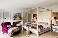 Decorator Isabel López-Quesada's Madrid bedroom is a chic space complete with a grand oak four-poster of her own design.