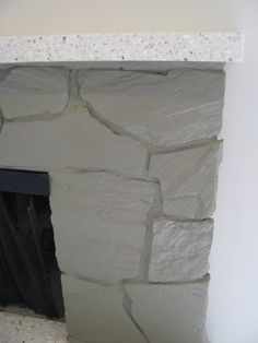 JOYS OF HOME: Painting a Rock Fireplace Like this.
