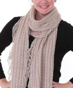 Traced with a polka dot lace hem, this scarf tops off an ensemble with feminine texture. Wool-blend fabric offers warm comfort.