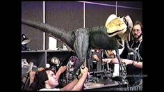 Behind the scenes of JURASSIC PARK. Stan Winston Studio Dinosaur mechanics Rick Galinson (hands only), Rich Haugen and Craig Caton-Largent puppeteer the animatronic Spitter (Dilophosaurus) puppet.