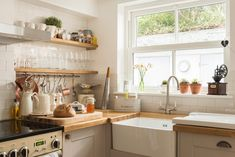 Enjoy boutique luxury at Kitty's Cottage - St Agnes. Boutique Retreats, Butler Sink, St Agnes, French Grey, Open Shelving, Small Spaces, Saints, Kitchen Cabinets, Cottage