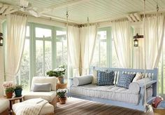 Love the idea of an enclosed porch with windows and/or doors you can open wide when the weather's great