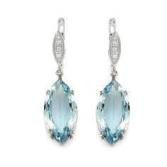 #Gold earrings with #diamonds and #topazes   White gold with diamonds and beautiful blue topazes.   See more of our #jewellery !