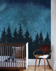 Our Forest Trees Night Scene Mural Wallpaper is naturally peacefully, from the silhouetted pine trees to the midnight sky full of stars. The peel-and-stick application makes it easy to quickly transform any room into a cozy retreat!  Mountains Wallpaper, Mountains Wall Art, Fabric Wallpaper, Peel and Stick Wallpaper, Repositionable Wallpaper, Temporary Wallpaper, Patterned Wallpaper, Wall Art, Wall Decor