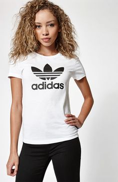 """Basic but big on style, the Adicolor Trefoil Short Sleeve T-Shirt keeps you in total comfort. This adidas short sleeve tee is made from pure cotton with a ribbed crew neckline and an iconic Trefoil logo on front. Match it with track pants or jogger shorts.    Crew neckline  Short sleeves  Trefoil logo on front  Regular fit  Model is wearing a small  Model's measurements: Height: 5'8.5"""" Bust: 34"""" Waist: 24"""" Hips: 34""""  100% cotton  Machine washable"""