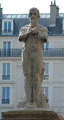 Estatua de Miguel Servet maniatado a la estaca de la hoguera, en la plaza Aspirant Dunand de París.