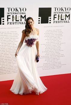 So pretty:The 41-year-old actress chose a gorgeous white pleated strapless number with st...