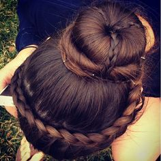 Lace rope braid into donut bun with English accent braids