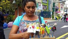 A woman sells religious dolls on the streets of San Salvador to the thousands of people who have come there for the Beatification ceremony of Archbishop Oscar Romero.