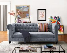 Modeled after its 18th-century forebearer, this stately Hanny sofa remains faithful to the original with handsome bronze nailhead trim and rolled English arms. Its oversized shape and grey velvet upho