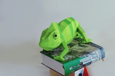 A Chameleon sculpture for your shelf! This DIY kit includes all 44 pieces you need to assemble the chameleon. The shown books are not included. The eyes will show in different directions. I copied this from the real Chameleon Fritz which sat as a model for me for this sculpture. This
