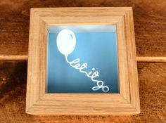 This simple and subtle 'Let It Go' miniature paper cut, is designed and cut by us. Framed in a beautiful handmade, real wood light oak frame. Price £25