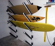 Kayak Storage Wall Last week Burns and I built a surf rack at his new house that will hold 8 longboards (or shortboards) on a standard wall in his garag. Kayak Storage Rack, Garage Storage, Diy Storage, Boat Storage, Storage Cart, Wall Storage, Closet Storage, Surfboard Storage, Surfboard Rack