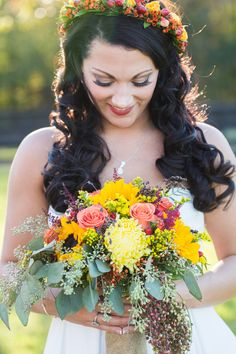 Colorful wedding bouquet, vibrant yellow and orange florals, roses, sunflowers // Emily Bartell Photography
