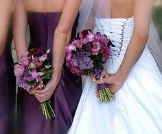 shades of purple flowers with the green stems showing and some green foliage filler.