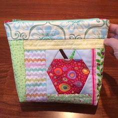 Zippered pouches with apple design on it.  Perfect for teacher's gifts!  Used Quilt As You Go (QAYG) method and paper pieced apple from a Carol Doak book.  - Patchwork Duck Designs