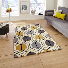 The contemporary Geometric design in Grey and Yellow is sure to be a focal point in any room of your home.