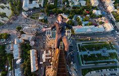 Vitaly Raskalov and his friend Alexander Remnov call themselves skywalkers. As one can see, they capture incredible, vertigo-inducing pictures of each other on top of the highest buildings in Moscow and other cities in Russia. Photo by: Vitaly Raskalov Selfies, Cool Pictures, Cool Photos, Crazy Photos, Amazing Photos, Modern Metropolis, Daredevil, Climbers, Pantone
