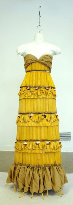§A dress made from post-its, colored pencils, cardboard, uncut keys, and pencils. Wow! via The Printable Press Blog.