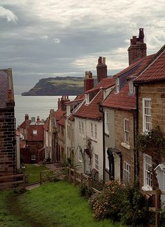 bluepueblo: Robin Hoods Bay, Yorkshire, England photo via gregori enchantedengland: Ooooh we did go here! Well, not HERE in these peoples back gardens which is really very rude. It is very close to Whitby, on the coast of North Yorkshire. Places To Travel, Places To See, Places Around The World, Around The Worlds, Robin Hoods Bay, England And Scotland, English Countryside, British Isles, Dream Vacations