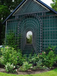 Optical illusion trellis with mirror in center.