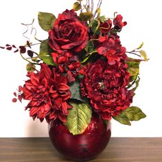 A personal favorite from my Etsy shop https://www.etsy.com/listing/230512722/tuscan-silk-floral-arrangement-scarlet
