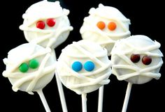 Mummy Cookie Pops-Oreos You could do orange frosting for pumpkins a mini-chip or pretzel for stems