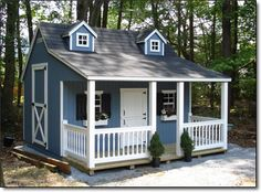We need one of these at the cabin for the grandkids.  Country Cottage Playhouse from Lancaster county bards.  Yes!