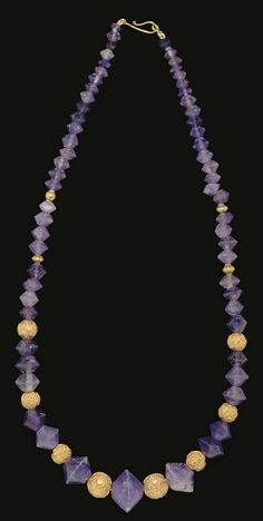 A GREEK AMETHYST BEAD NECKLACE   HELLENISTIC PERIOD, CIRCA 3RD-2ND CENTURY B.C.   Composed of sixty-three biconical amethyst beads, graduated in size, interspersed with modern gold beads; strung with a modern S-hook closure  23 in. (58.4 cm.) long