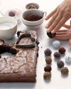 Brownie Hearts and Brownie Bites Recipe -- After you cut out the hearts, roll the brownie leftovers into bite-size morsels. Once coated with cocoa or sugar, they resemble truffles. You'll get about 44 bites.