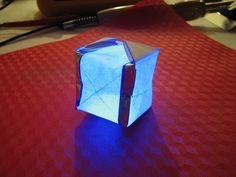 Create this beautiful LED lit cube using a combination of basic electronics and origami.