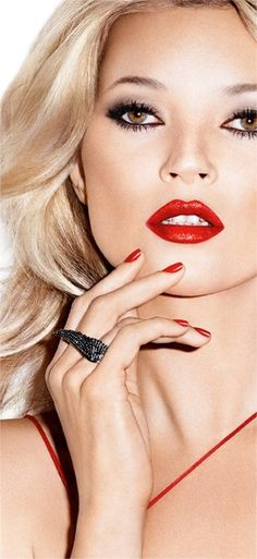 Seductive Kate Moss with bold red lipstick