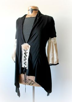 Womens, upcycled, boho chic, black, lace-up, tunic top in size large. One-Of-A-Kind, Eco-Friendly, Handmade Clothing for Women, Plus Size Women and Children.  SHAWNA Top  This one of a kind top is made from stretchy fabric and features shimmery sleeves that puff out below the elbow and have lace trim. Theres a lace-up section on the lower front. (the polka dot top shown underneath in photos is not included) Womens size large Bust: will fit 37-40 inches (94-102 cm) Waist: will fit up to 36…