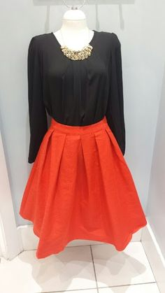 Mikarose black long sleeve pleated top 34.99, Red pleated textured a-line skirt 39.99