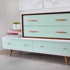 Painted vintage Mid-Century Modern dresser in high-gloss mint and white with metallic copper spray painted vintage hardware.
